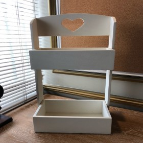 Side shelf for newspapers and book keeping