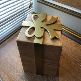 Wooden box and golden rose